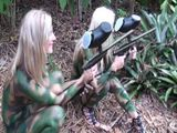 naked chicks shooting each other with paintballs