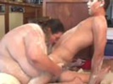 Fat chick covered in food sucking of skinny man's dick.