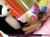 Chick plays with unusual panda