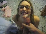 Cute girl in glasses gets a big facial
