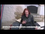 Busty redhead Fay fingering herself in smooth leather
