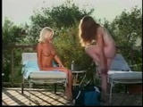 Two Blondes By The Pool licking