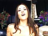 Splashing on Carmella's big boobs