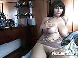 Brunette with busty boobs masturbating on cam