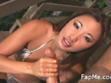 Lovely Asian girl wanking a nice dick