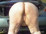 Fat Woman Pissing Behind The Car - Pissing Videos