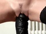 Kinky amateur slut fucking a gigantic fat dildo