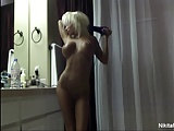 Nude Nikita dries off after a sexy shower