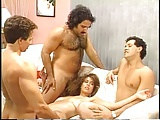 Christy Canyon surrounded by cock
