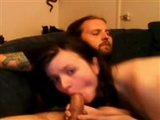 She looks straight at the camera while sucking cock