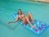 Gorgeous blondie german milf pissing in her pool